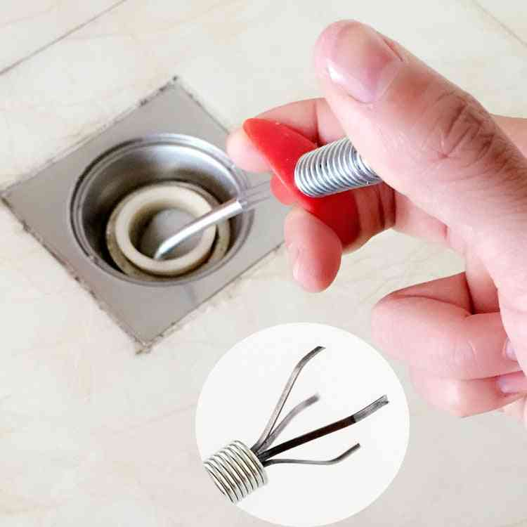 Hand Bending Pressure Sewers Clip Tool To Remove Hair From Drain Pipeline