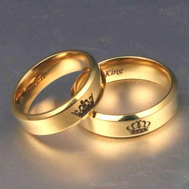 Kullanvärinen kuningas- ja kuningatar-ruostumattomasta teräksestä valmistettu kruunupariskunta rakastaa miesten / naisten lupauksia