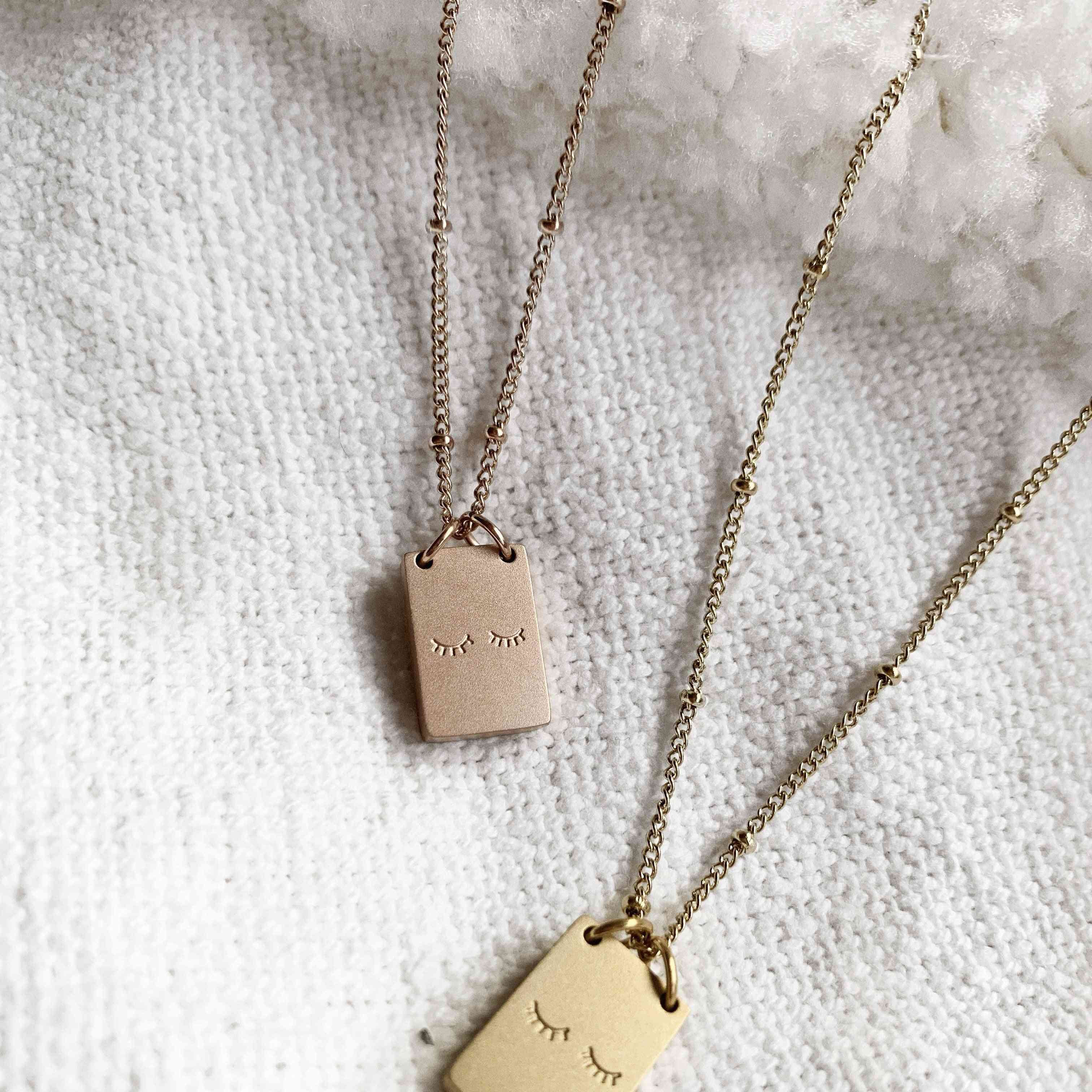 Two Little Lashes On A Stainless Steel Block Necklace