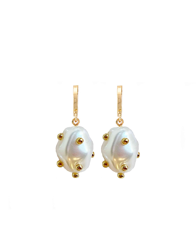 Clara Pearly White Huggie Earrings